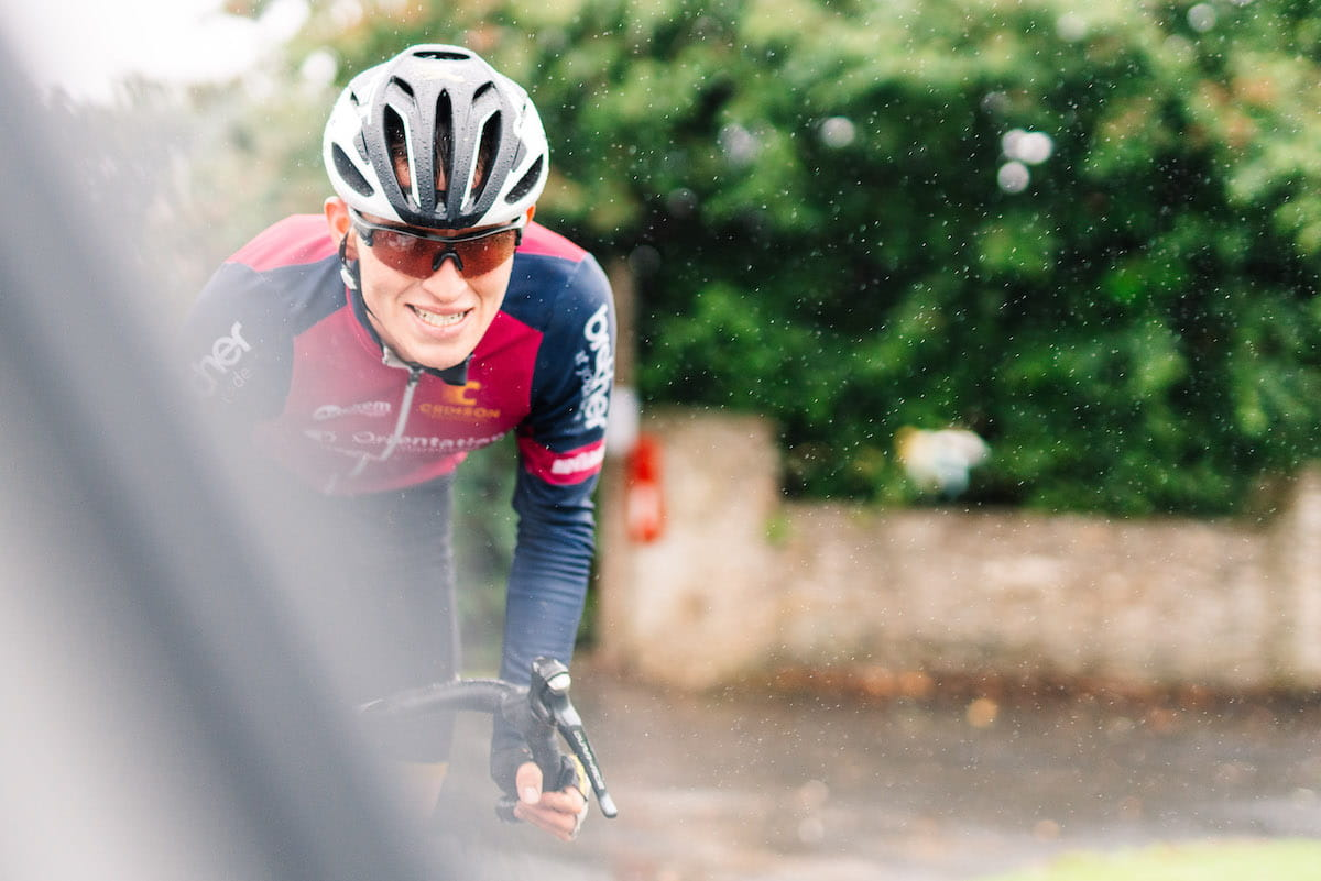 Cyclist during a race with helmet and glasses
