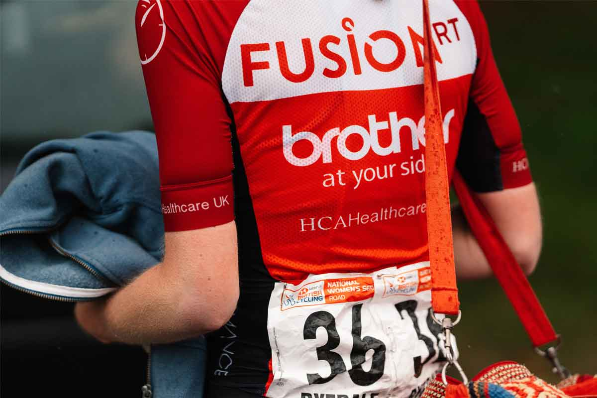 Cyclist with Fusion RT's cycling jersey with Brother logo