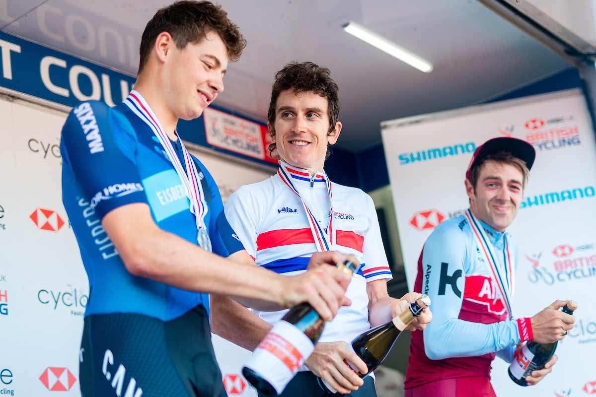 Three cyclists opening champagne