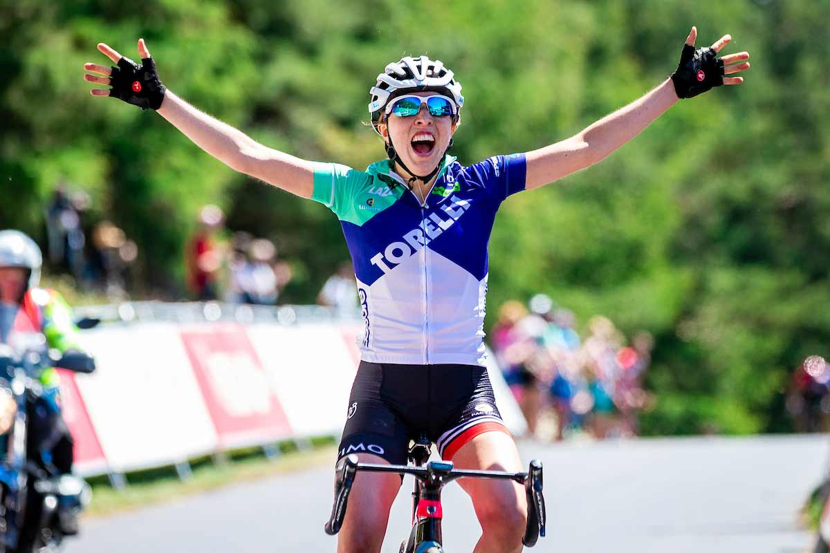 Sophie Wright celebrating a road race win
