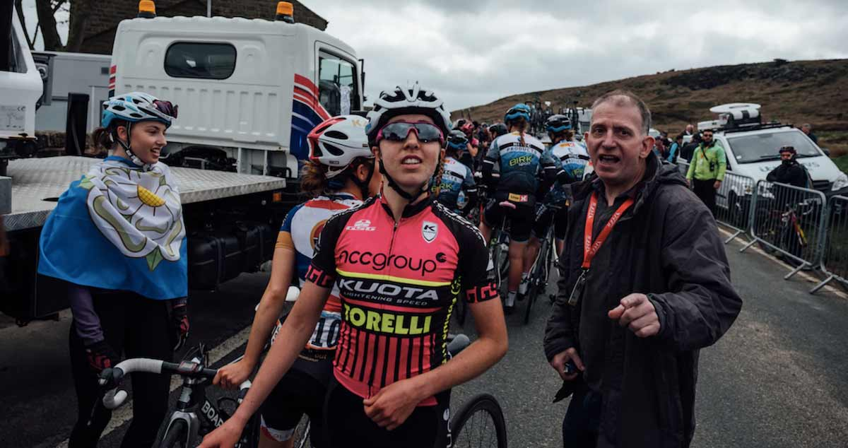 Cyclist Sophie Wright chatting with other cyclists