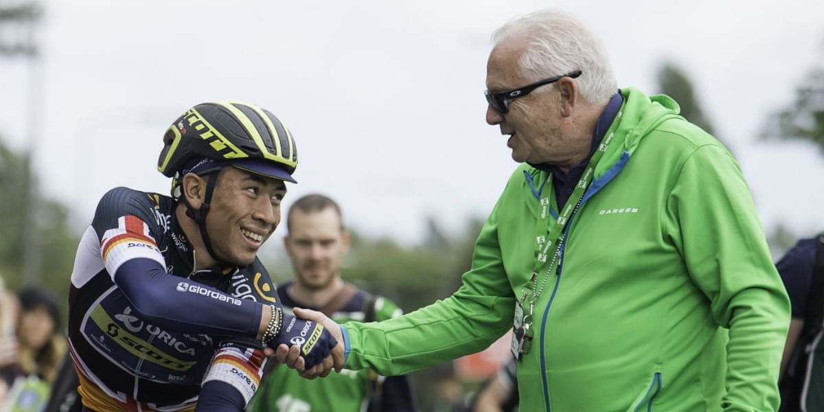 cycling winner shakes hands