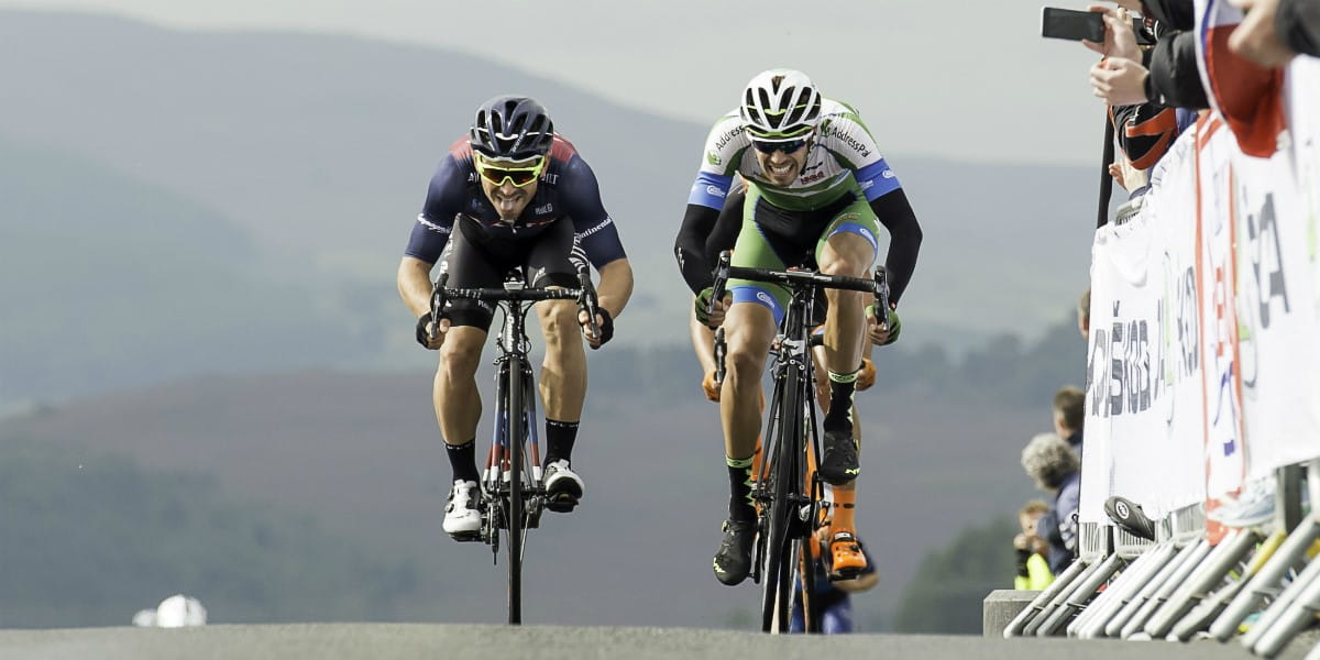 cyclists battling it out at the top of a climb