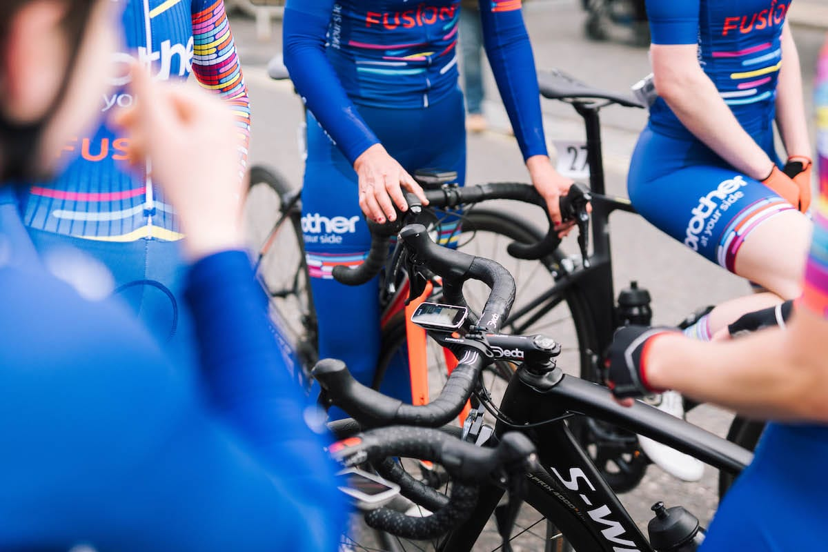 Cyclists wearing Brother UK-FusionRT team colours gathered together on bikes