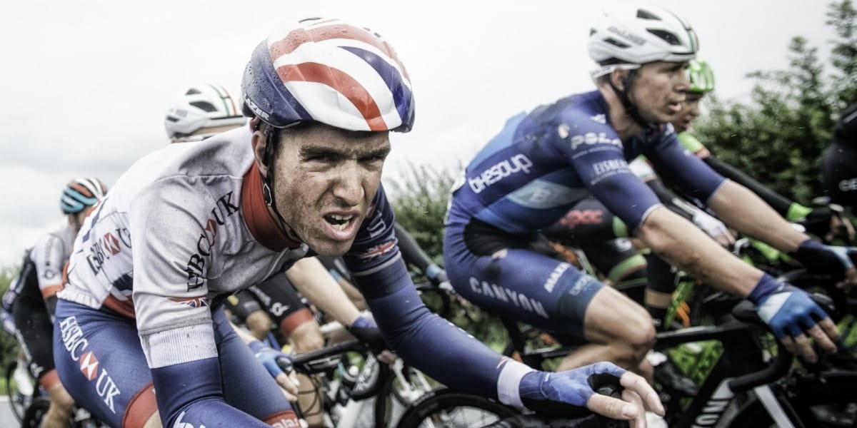 cyclist grits his teeth mid-way through the race