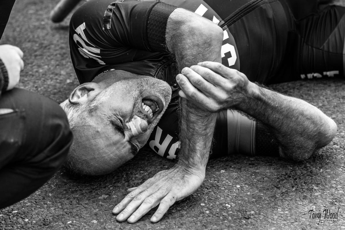 Cyclist Rich Stoodley lying on the ground in pain after a gruelling hill climb