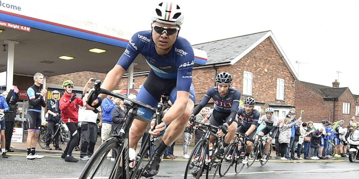 cyclists lean into corner