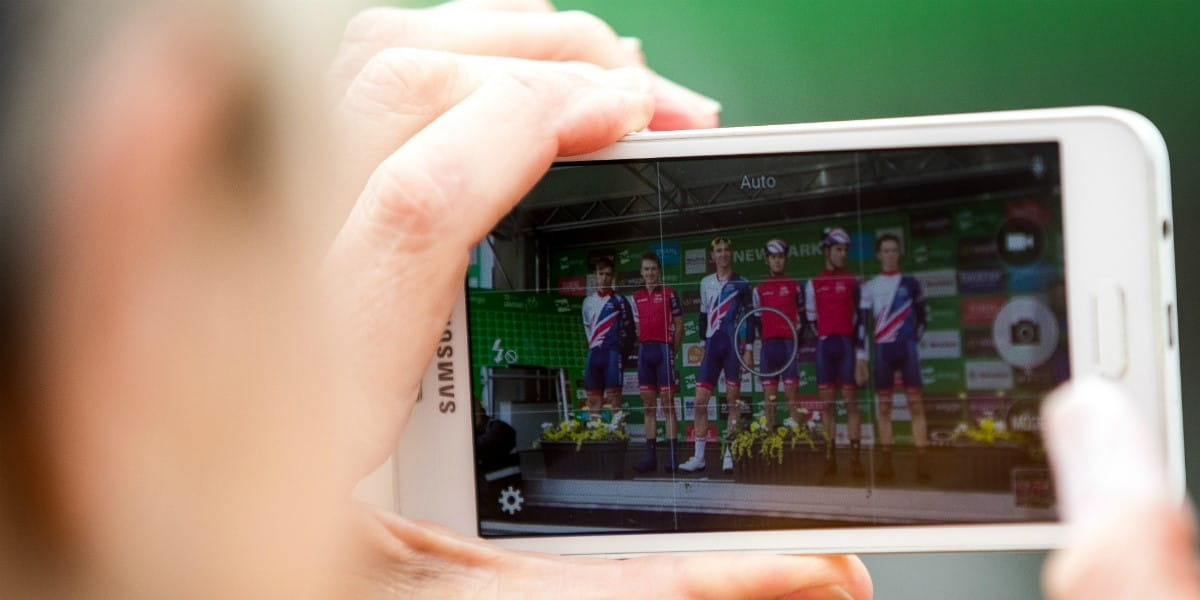 photograph of someone taking a snap of the podium on their smartphone