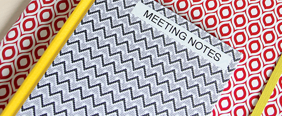a labelled meeting notebook