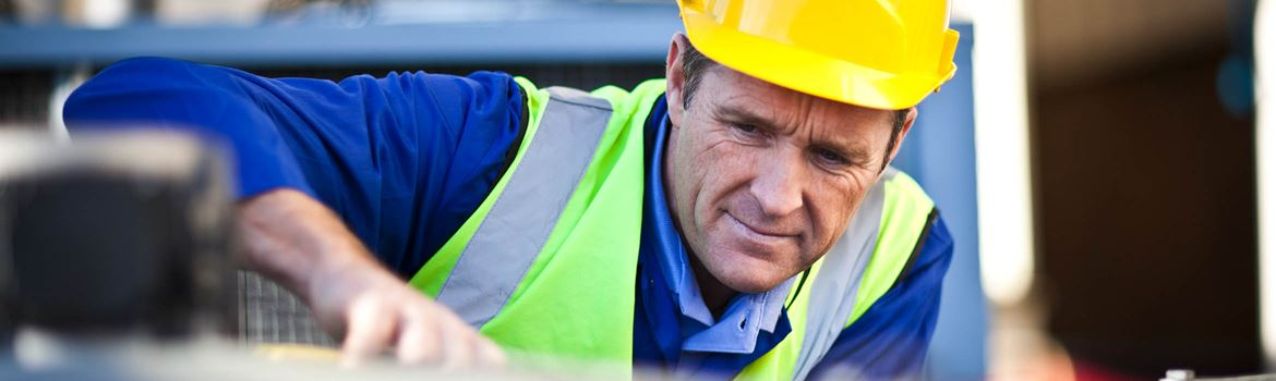 Man in a hardhat and high vis
