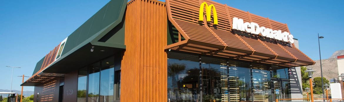 Exterior view of a McDonald's restaurant on a sunny day in Spain
