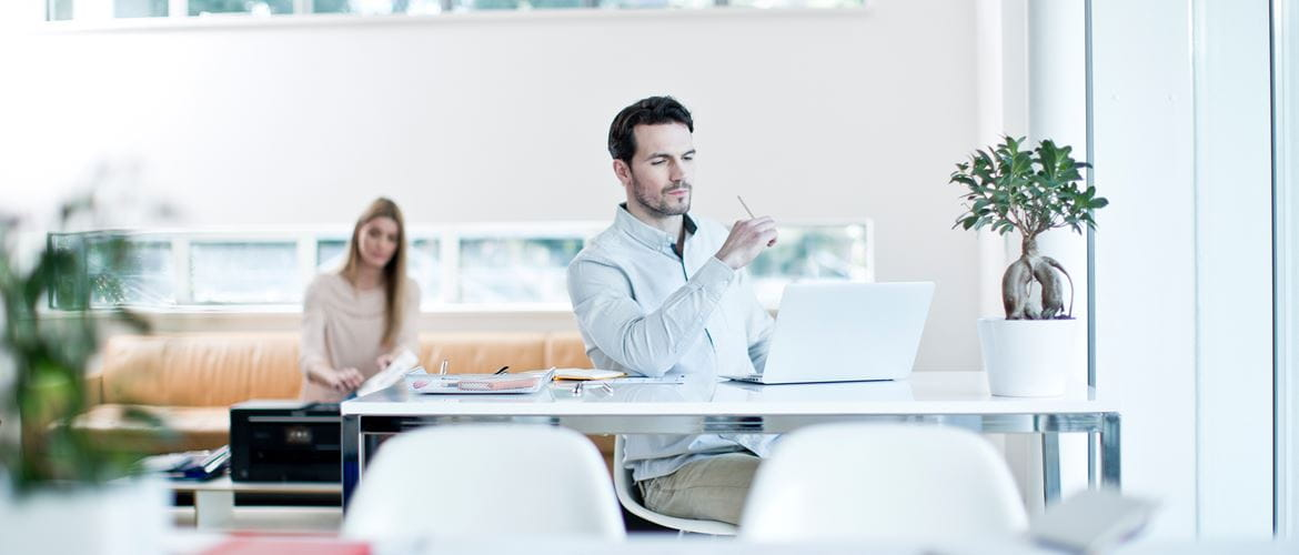 Man sitting at a desk working in an office
