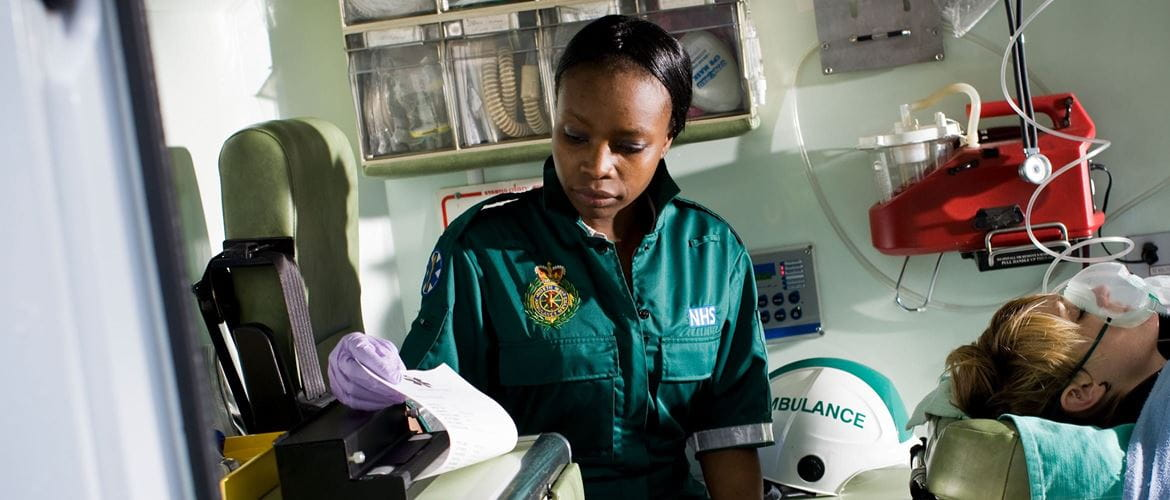 Patient record being printed on a PJ Brother portable printer by a paramedic in ambulance