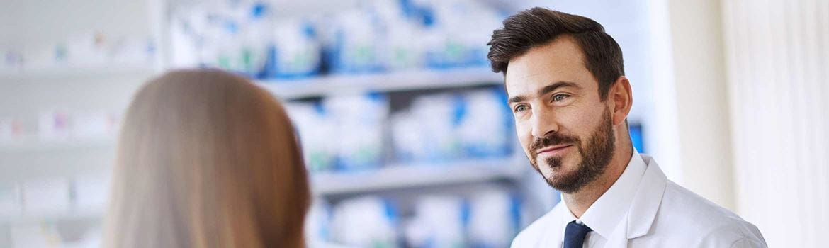 Two pharmacy colleagues chatting to each other