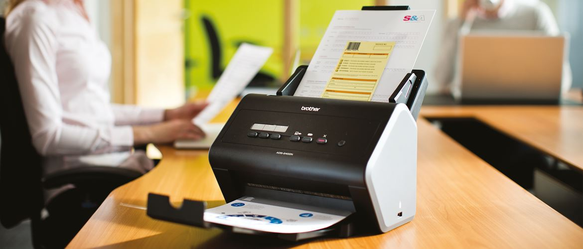 A Brother printer on a desk using the Barcode Utility upgrade