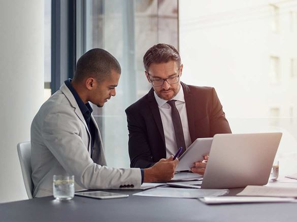 Brother business transformation expert working with an IT professional to define a productivity strategy