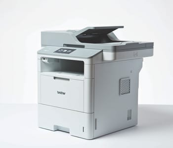3/4 view of Brother MFC-L6900DW laser printer on white surface and background
