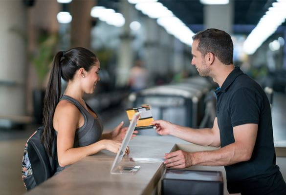 Woman at the gym talking to receptionist