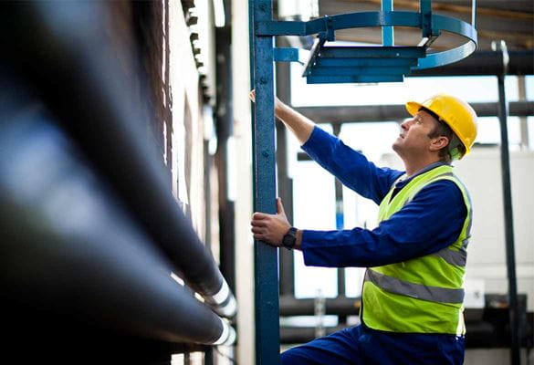 Gentleman climbing a ladder in a warehouse