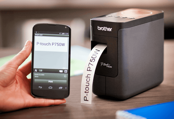 A person printing a a label from a smartphone to a Brother P-touch P750W wireless desktop label printer