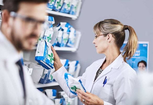 Pharmacist with a customer order