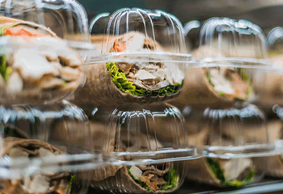 packaged sandwiches in a fridge