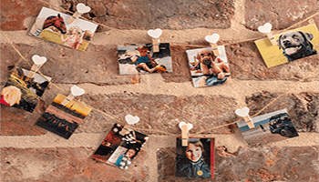 photos on an exposed brick background