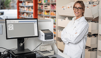 Pharmacy employee with the Brother TD label printer