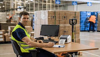 Warehouse employee using the Brother TD label printer