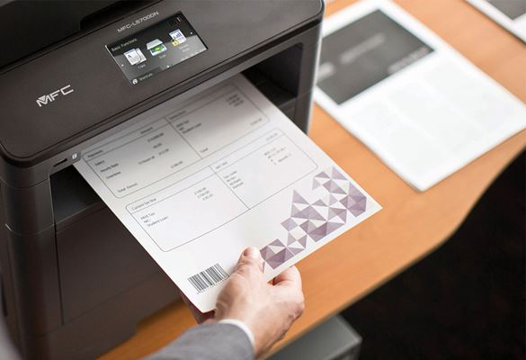 Mans hand taking a document with barcode printed on bottom left hand corner from Brother MFC-L5700DN multifunction mono laser printer