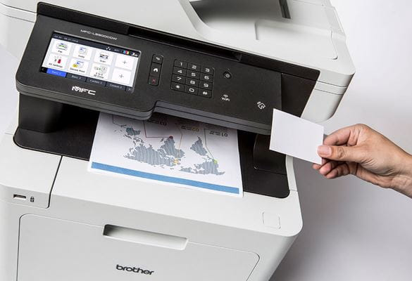 Brother MFC-L8900CDW multifunction colour laser printer hand holding NFC card for secure printing