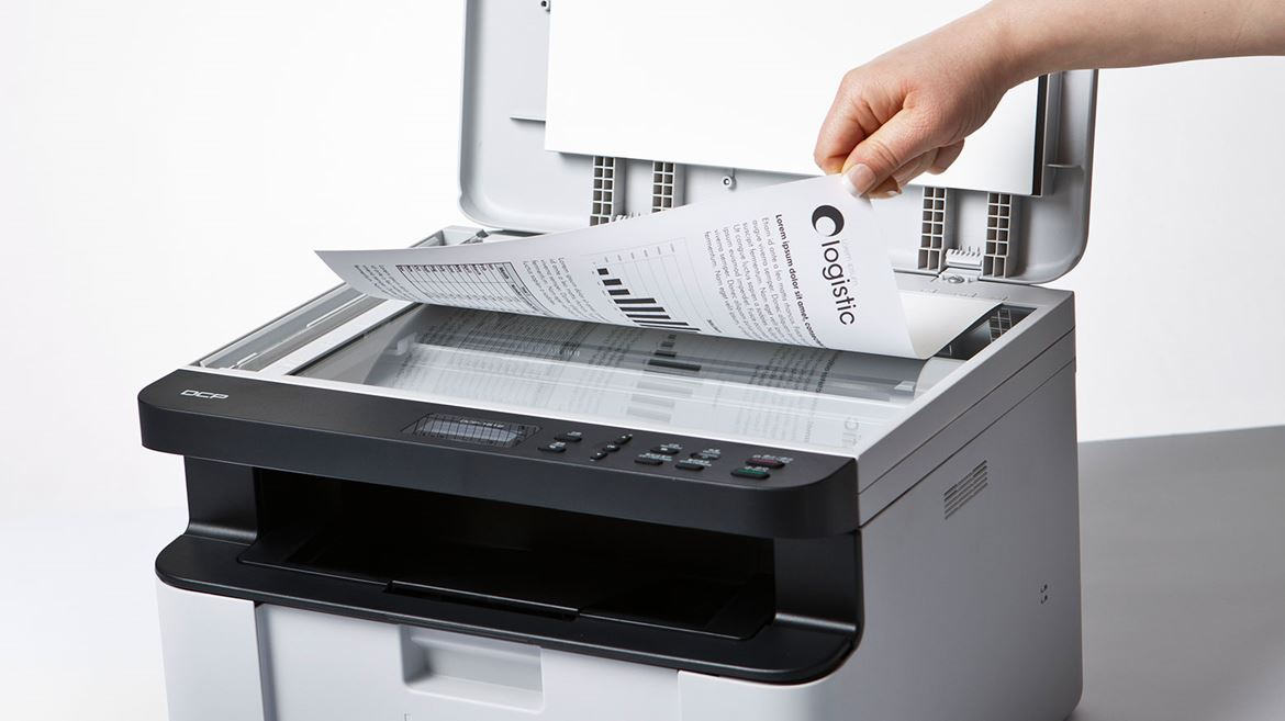 Person scanning document on printer