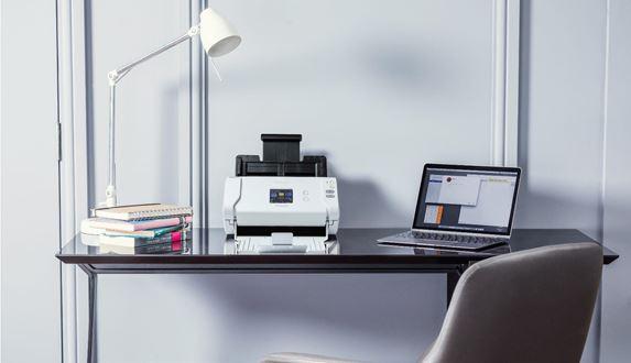 Brother scanner on wooden home office desk