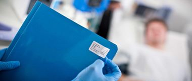 a blue patient folder clearly labelled with patient information