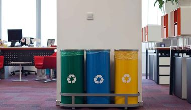 Three recycling bins in an office