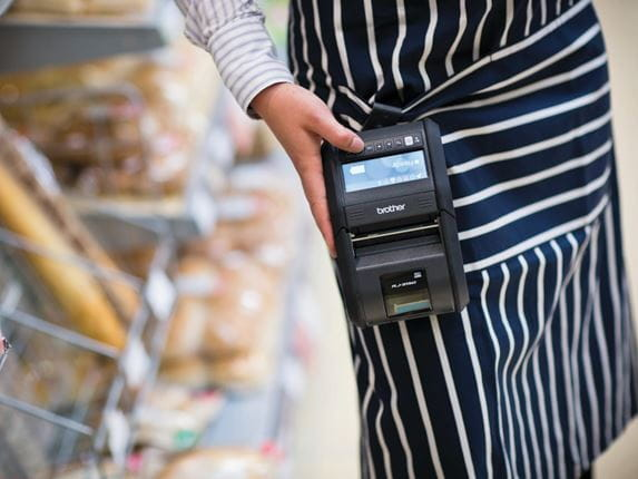 Retail staff wearing RJ-3150 Brother device in store environment