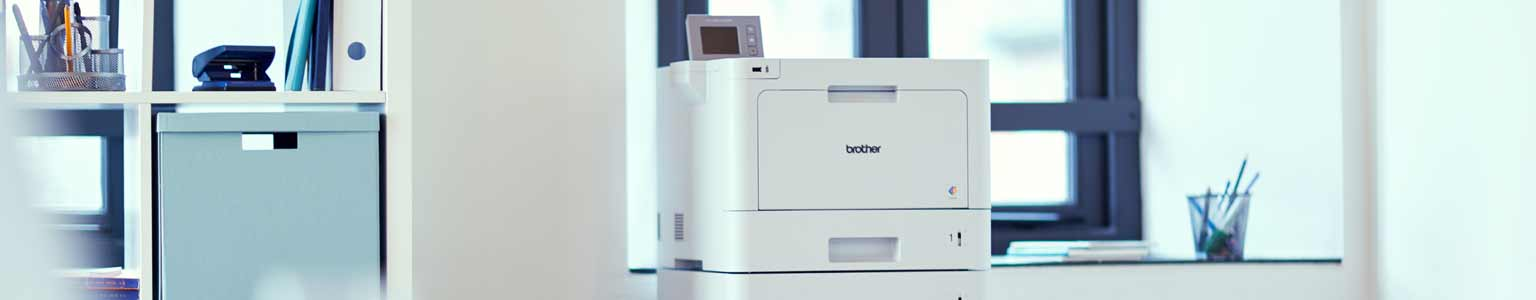 Brother Colour laser printer in the background of an office