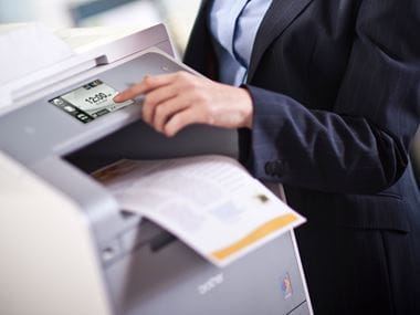 man using a brother printer