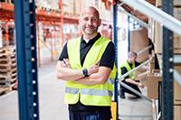 warehouse employee wearing a hi vis jacket