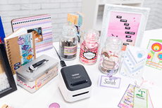 A mobile label printer on a table with items that have printed labels