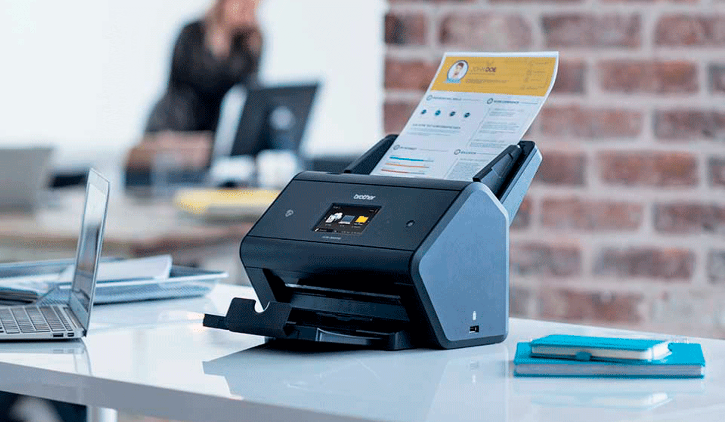 Brother scanner on a desk in an office environment
