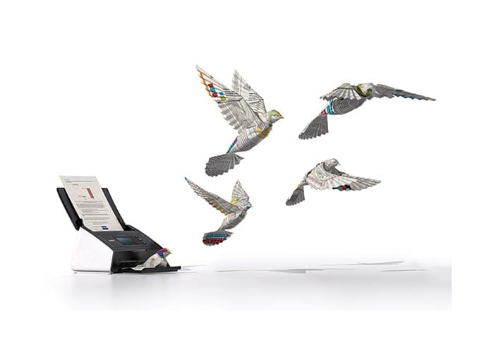 Illustration of paper birds flying out of a Brother scanner