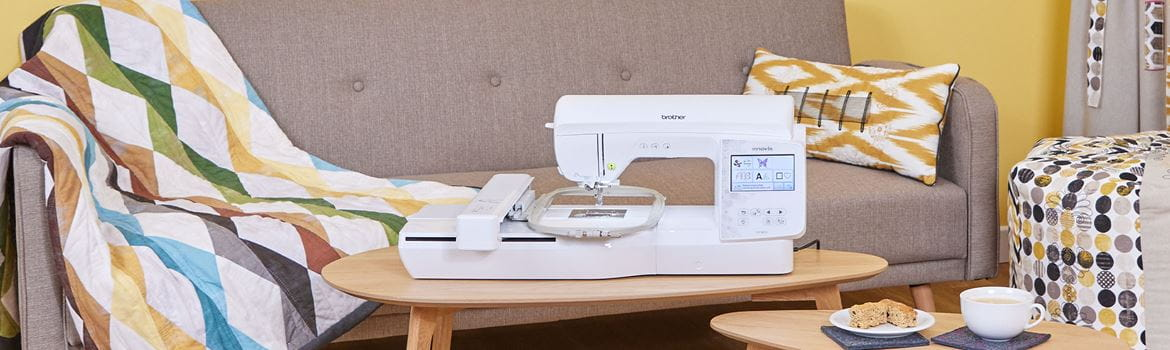 Brother Innov-is NV880E embroidery machine on coffee table