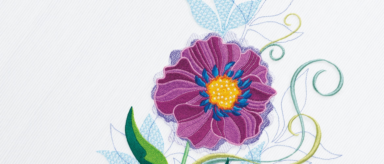 Blumenstickerei auf grauem Hintergrund