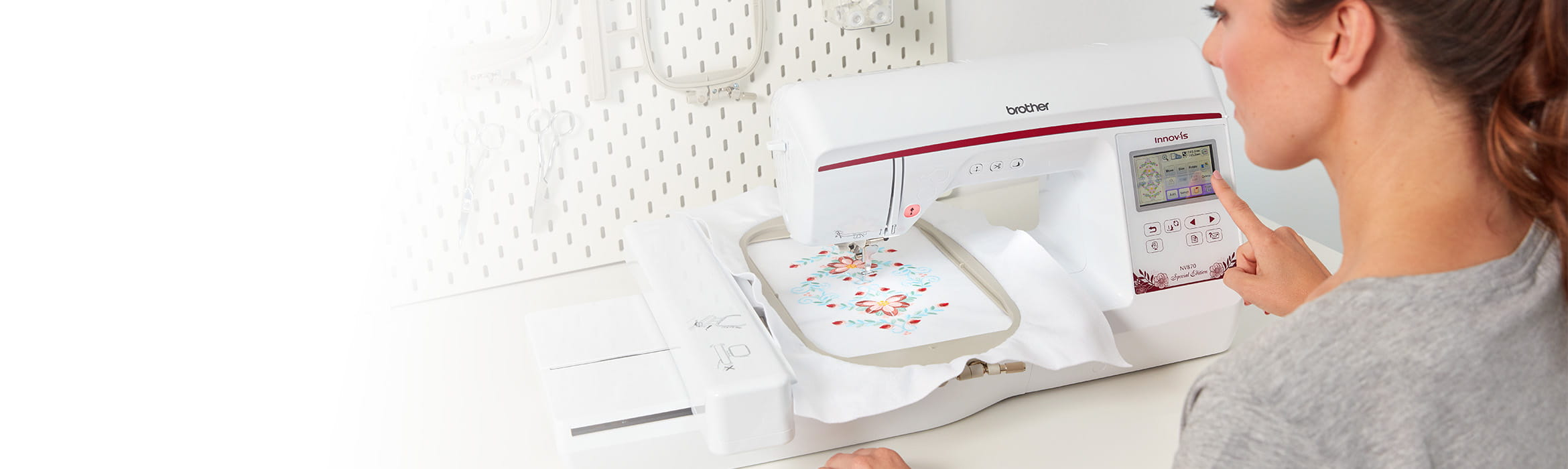 Woman using the Brother NV870E embroidery machine