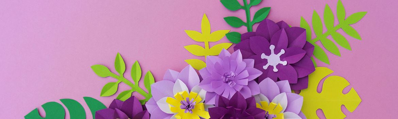 Purple paper flowers on light purple background