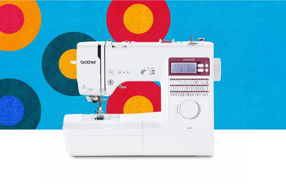 A50 sewing machine on a blue background with coloured circles