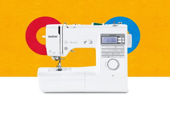 A80 sewing machine on an orange background with coloured cirlces
