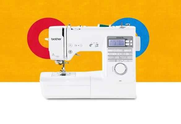 Швейная машина A80 на оранжевом фоне с цветными кругами