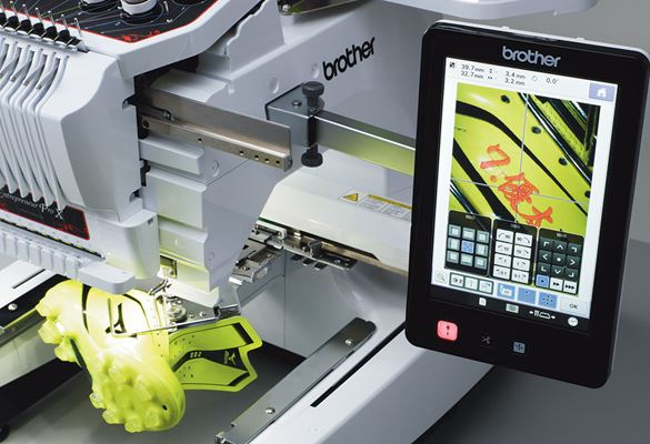Camera function on embroidery machine shows design position